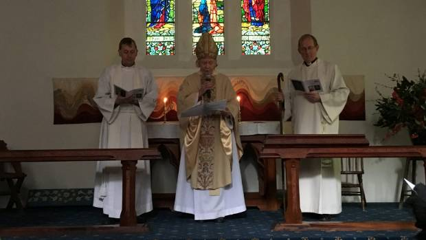 Arch Deacon Peter Carrell, left, Bishop Victoria Matthews and Reverend John Hayhoe at the re-dedication service.