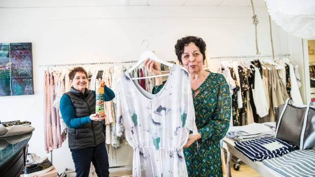 Womens Refuge manager Katie O'Donnell(left) and Shine owner Jo Menary promote a charity fashion event, in which you can ...