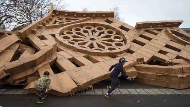 The cardboard box cathedral collapsed in a general corkscrew fashion after the bad weather. No-one was inside at the time.