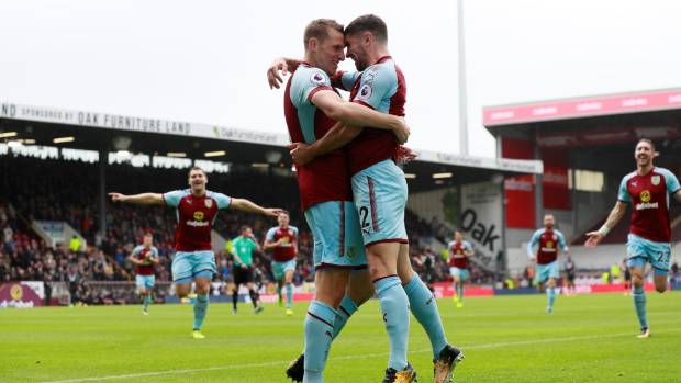 Chris Wood celebrates his goal with Burnley team-mate Robbie Brady.