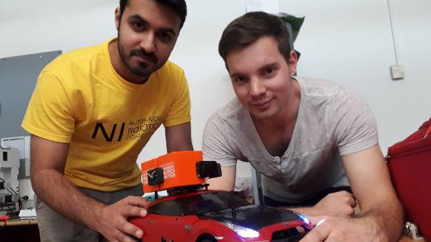 Nikhil Sethi and Michael Redstall with their winning robot design.