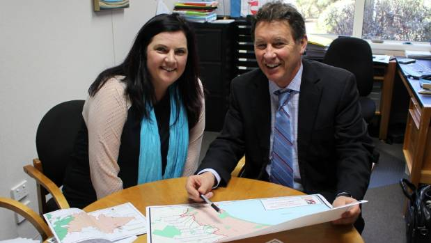 Julz Satherly with Taupō-nui-a-Tia College principal Peter Moyle, look over the new zoning plan.