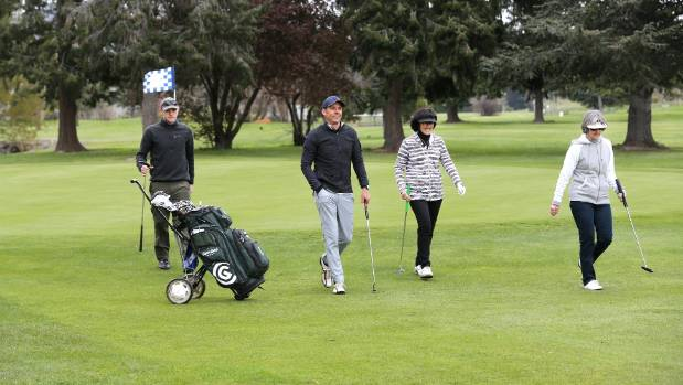 The Gaswicks team of, from left, James Gilmour, Scott Wright, Kaye Dickson and Sue Greensheet head for the 10th tee ...