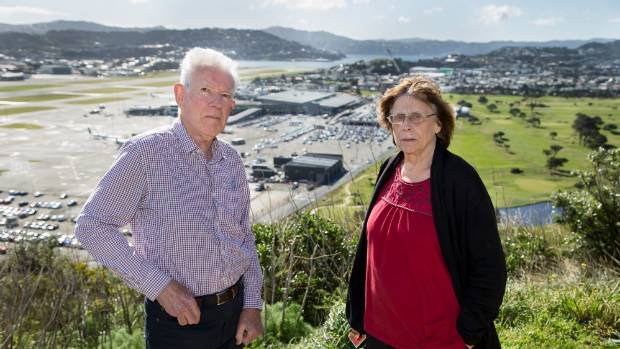 Residents' representatives Glenn Kingston, left, and Robin Boldarin with Wellington Airport and the neighbouring Miramar ...