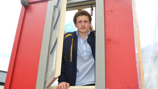 Marlborough Boys' College student Connor Reed looks out of a newly-installed window of the team's tiny house.