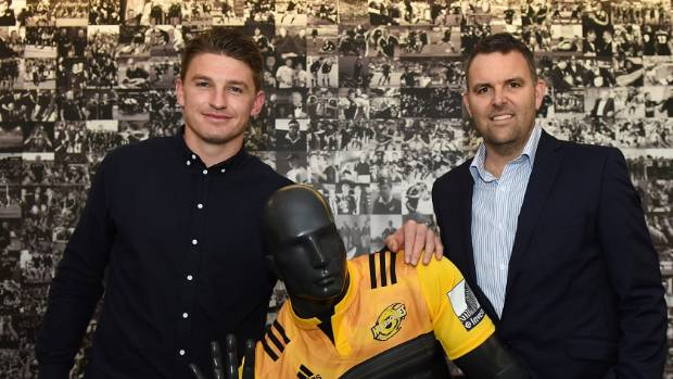Hurricanes chief executive Avan Lee, right, poses with Beauden Barrett after the first five-eighth re-signed with the ...