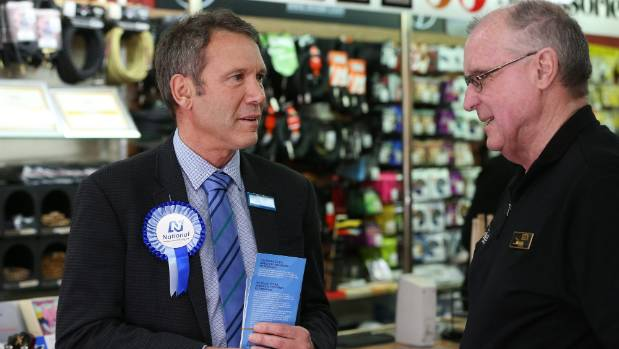 Kaikōura MP Stuart Smith talks to music shop owner Ken Ham on the campaign trail.