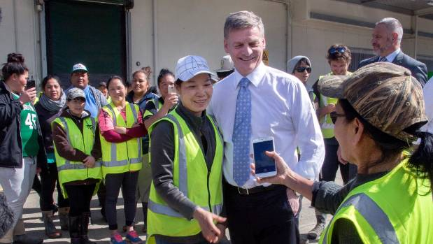 Prime Minister Bill English agrees to a photo while visiting Levin to announce a $20m farming fund.