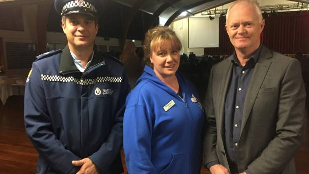 Senior Sergeant Scott Richardson of Nelson, Nicola Barre of the Victory Community Centre and Peter Bramley chief ...
