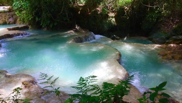 The clear waters of Tat Kuang Si Waterfall, 45 minutes' drive from Luang Prabang.
