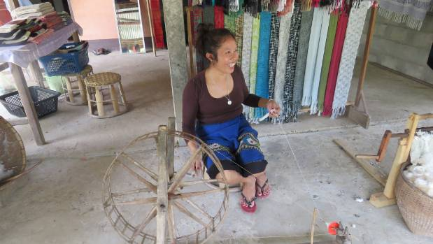 Pan runs a little cotton weaving business from her home near Tat Kuang Si Waterfall.