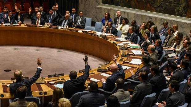 Ambassadors to the UN vote during a United Nations Security Council meeting on North Korea in New York City, US.
