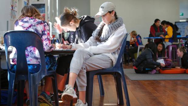 Year 7 and 8 pupils are using the school's chilly, echoing school hall as a classroom as Kahurangi School waits for ...