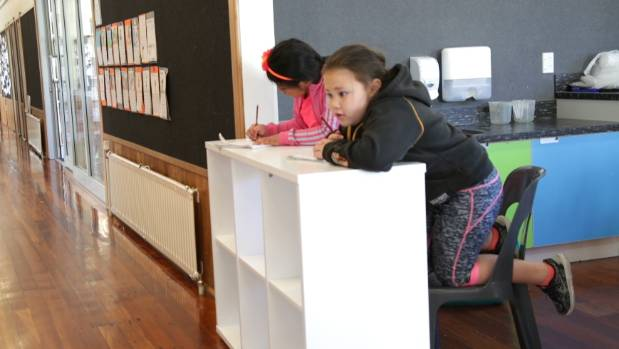 Up to 30 pupils are using the school hall, a utilities room bordering a hallway and a room designed for 'extra' learning.