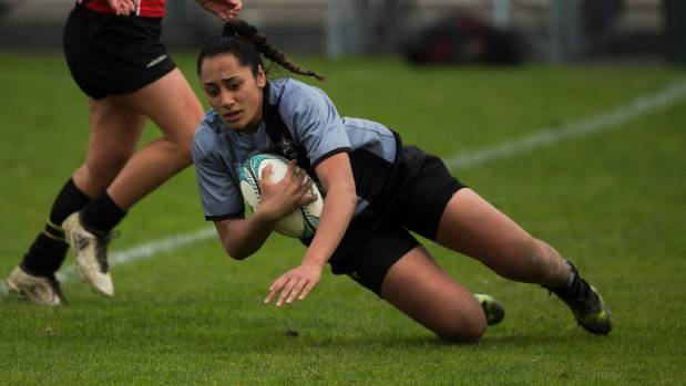 St Mary's captain Dhys Faleafaga scores a try against Manukura in the girls' Hurricanes secondary schools rugby final ...