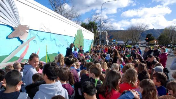 Upper Hutt School pupils check out their new mural on Blenheim St.