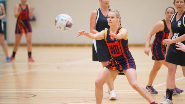 Harlequins Woodbourne wing defence Rachel Broadbridge passes down court during the grade one final.