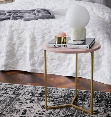 Proving that pink can serve as a neutral, the Verona collection pink side table from Adairs looks at home paired with ...