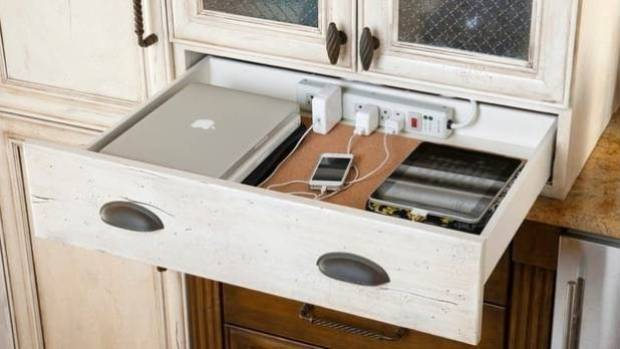 A neat charging station - in the kitchen or study - keeps all your messy cords and chargers in one place.