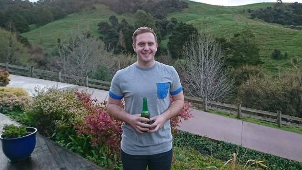Auckland man Bradley Scales celebrates with a beer after NZTA announced its variable speed limits on SH16 and SH20 would ...