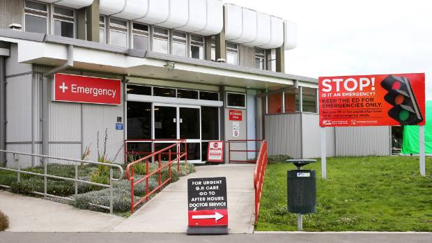 Signs outside Wairau Hospital's emergency department, in Blenheim, urge patients to consider if a GP could treat them ...