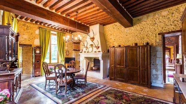 The French country kitchen is positioned within the original tower.