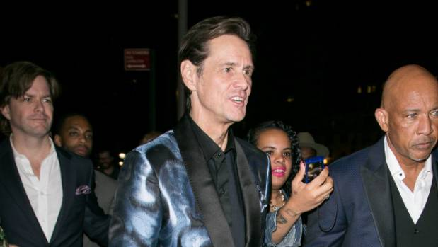 Jim Carrey arriving at fashion week with his body guard.