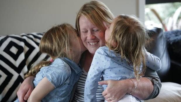Maree Ford with daughters Molly, 6, and Alex, 4. She is calling for funeral directors to be registered with a ...