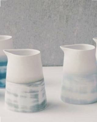Made by artist Renee Boyd, this minimalistic jug has a shibori finish, a technique borrowed from fabric dying. $70 from ...