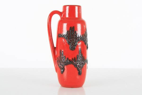 Made in Scheurich in West Germany in the 1960s, this vintage glossy red and black jug literally comes from a world ...