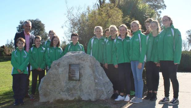 Renwick School pupils and principal Simon Heath celebrate having a poem from the school set in stone beside the Taylor River.