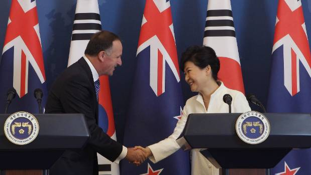 Former Prime Minister John Key shakes hands with former South Korean president Park Geun-Hye after the signing of a free ...