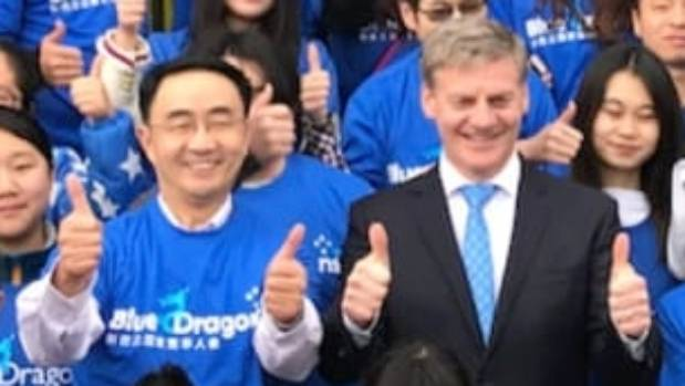 National list MP Jian Yang beside party leader Bill English with 'Blue Dragons' supporters at a party policy launch.