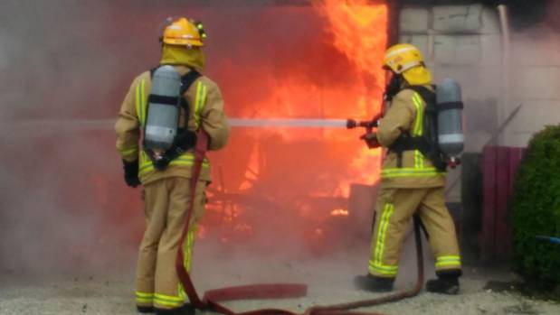 Firefighters from Te Kuiti and Otorohanga attend to the blaze at the house in rural Mahoe Rd.