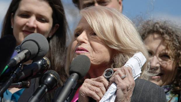 Plaintiff Edith Windsor shows a pin her late partner Thea Spyer gave her as engagement ring, as she talks to reporters ...