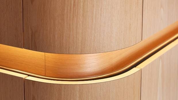 A niche around the cabinetry serves as a handrail guide so the owner can navigate easily around the flat.