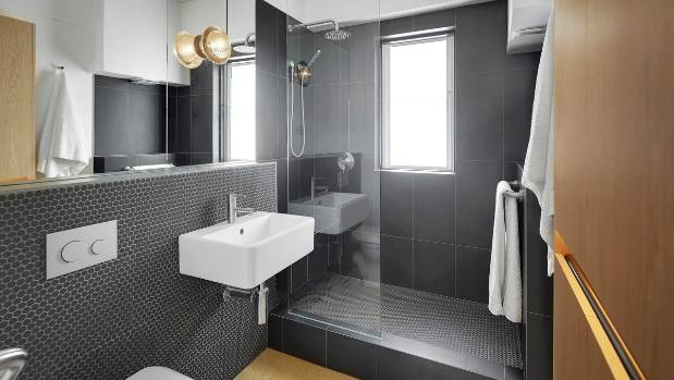 The bathroom tucks into the far corner of the unit. It can be closed off from the bedroom.