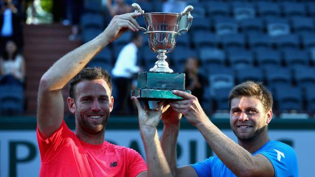 Michael Venus, left and partner Ryan Harrison of The United States celebrate victory with the trophy in the men's ...