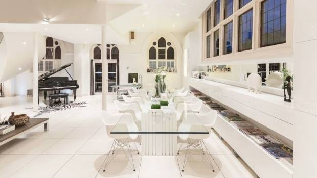The property is available to rent fully furnished and includes contemporary pieces, such as this glass dining table, ...