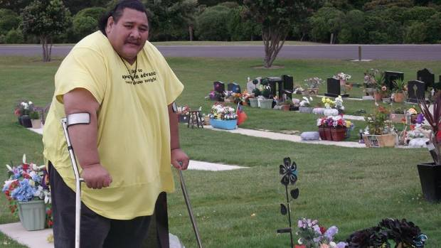 Petranoff Smith at his brother's grave, when he was at his heaviest.