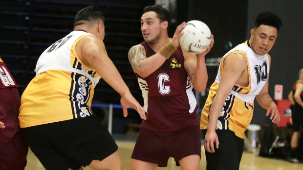 Wellington's Angelo Brown defends against Southland centre Rangi Rogers with Wellington's Peato Lese close by.