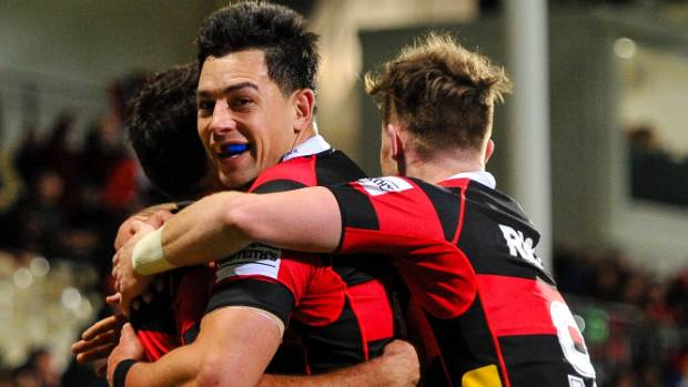 Canterbury's Rob Thompson and Mitchell Drummond celebrate one of Tim Bateman's tries.