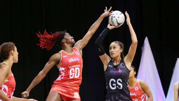 New Zealand shooter Maria Tutaia lines up a shot under pressure from England defender Ama Agbeze.