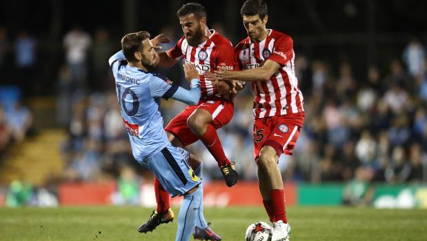 Milos Ninkovic of Sydney FC (left) collides with Melbourne City's Manny Muscat (centre) and Iacopo La Rocca.