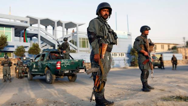 Afghan police officers stand guard at the site of a suicide attack in Kabul, Afghanistan.