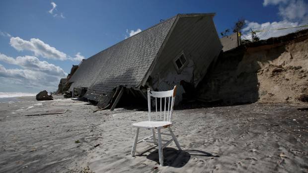 A chair is pictured outside a collapsed coastal house after Hurricane Irma in Vilano Beach, Florida, US.