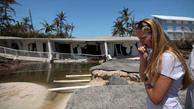 A local resident reacts as she sees the damage to her home after Hurricane Irma struck Florida, in Islamorada Key, US.