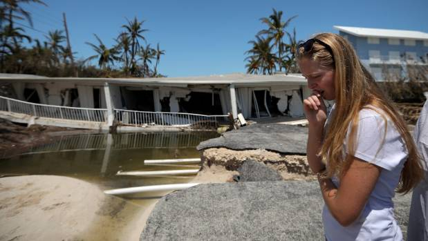 A local resident reacts as she sees the damage on her home after Hurricane Irma struck Florida, in Islamorada Key, US.