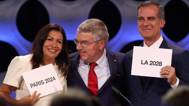 Paris mayor Anne Hidalgo (left) International Olympic Committee president Thomas Bach and Los Angeles mayor Eric ...