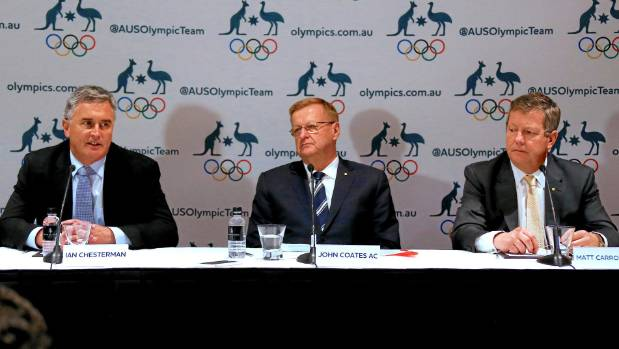 John Coates, President of the Australian Olympic Committee centre, and Matt Carroll, AOC's Chief Executive Officer, ...